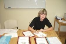 Подготовка дипломов к торжественной части.