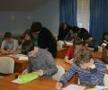 Участники Олимпиады и педагоги за просмотром работ.